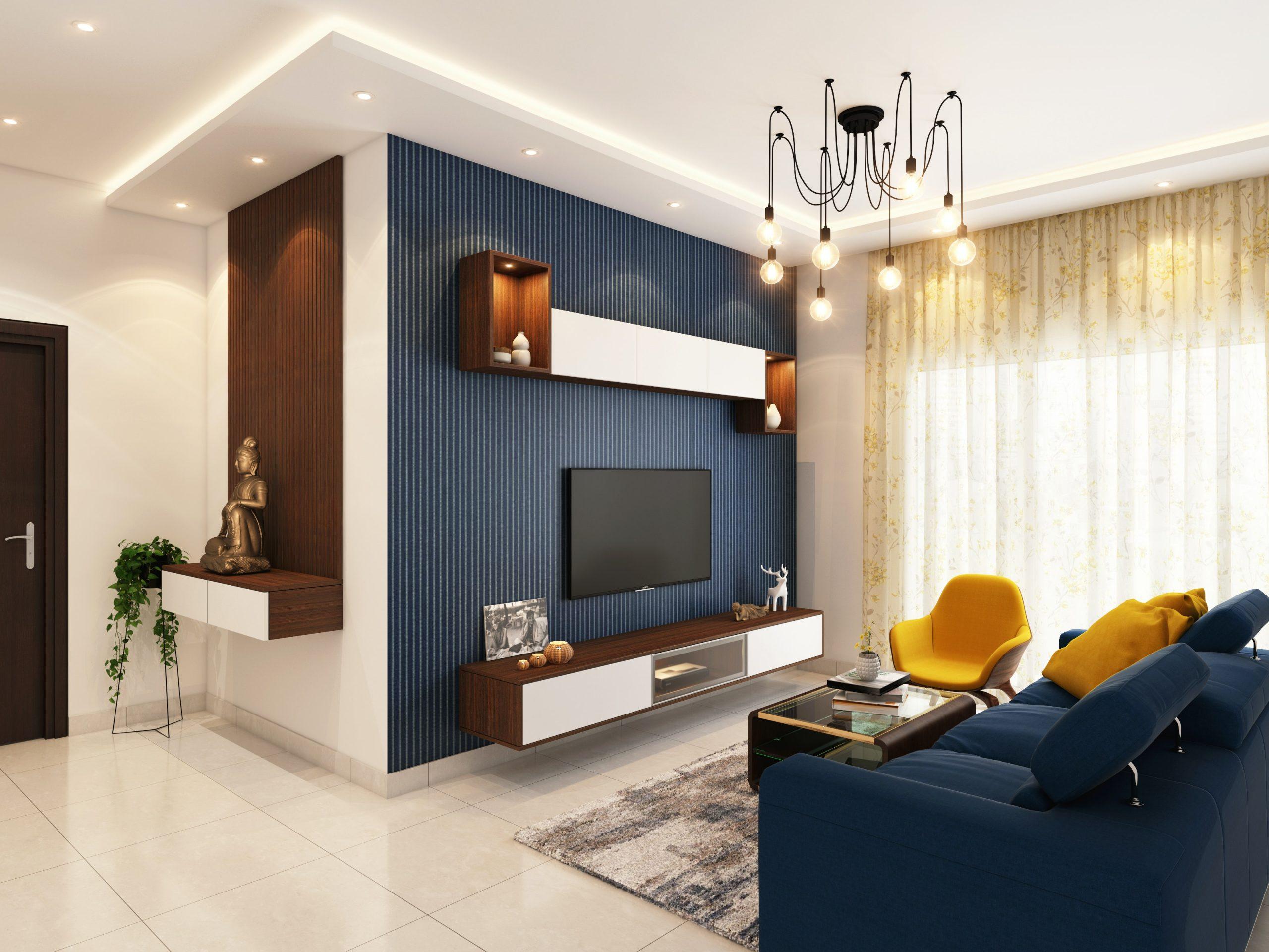 Na foto uma sala de estar pequena com sofá e painel de TV em azul marinho.